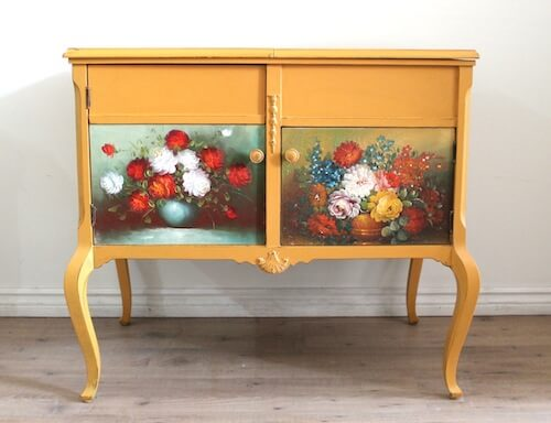 Yellow Sideboard With Paintings