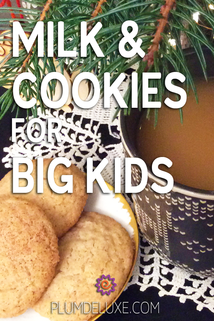 A plate of snickerdoodle cookies sits next to a mug filled with a hot tea cocktail on a white lace doily. Pine branches can be seen along the top of the photo. The overlay text reads: milk & cookies for big kids.
