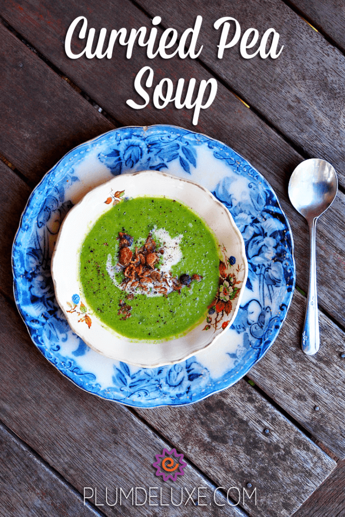 bright green curried pea soup in a blue and white toile dish