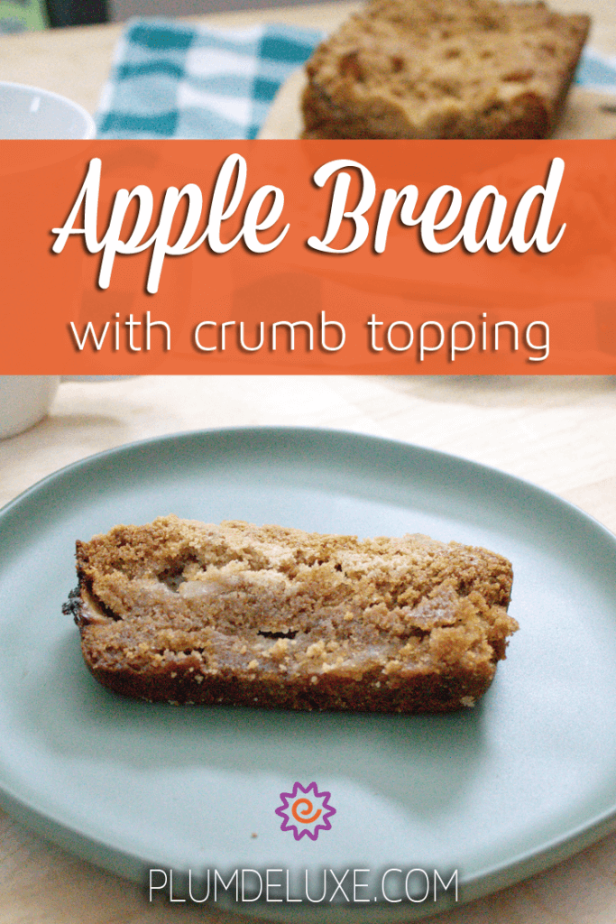 a slice of apple bread with crumb topping rests on a light blue plate