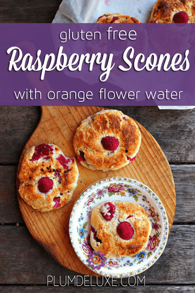 overhead view of gluten free raspberry scones in a flowered plate and wooden cutting board