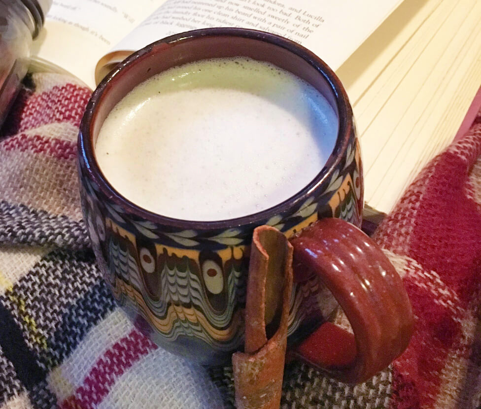 tea latte in a colorful handmade mug