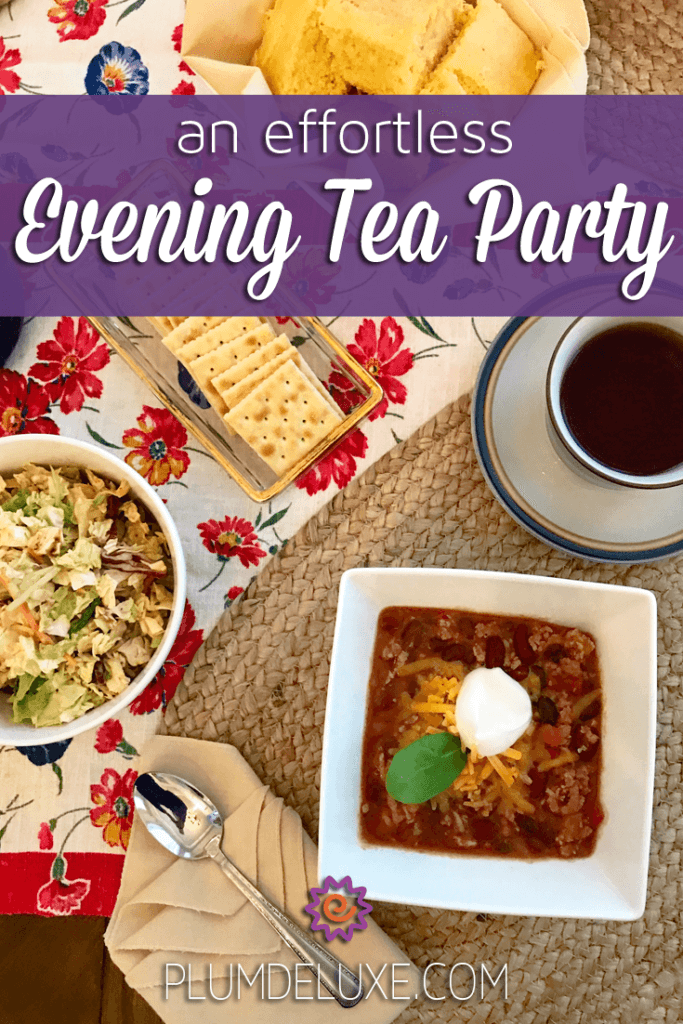 overhead view of an evening tea party table with turkey chili, cornbread, salad, and tea.