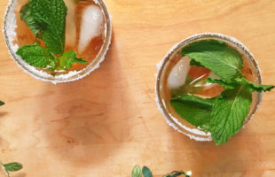 Overhead view of two glasses of iced Moroccan mint tea.
