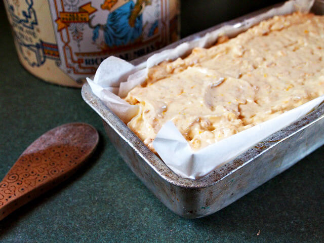 Grapefruit bread batter has been poured into a loaf pan and is ready to bake.