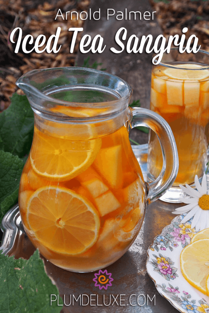 A pitcher of iced tea sangria is filled with wine, oranges, and other fruit.