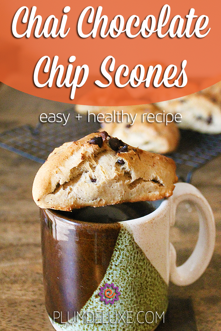 A chocolate chip scone sits on top of an earthenware mug of tea below the text: Chai Chocolate Chip Scones easy + healthy recipe