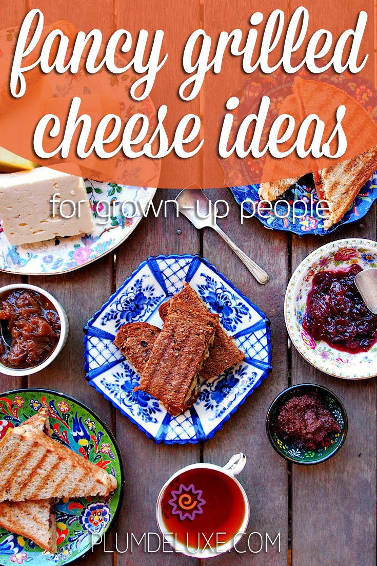 Overhead view of a wooden table full of grilled cheese sandwiches, cheeses, and sauces with the text: fancy grilled cheese ideas for grown up people