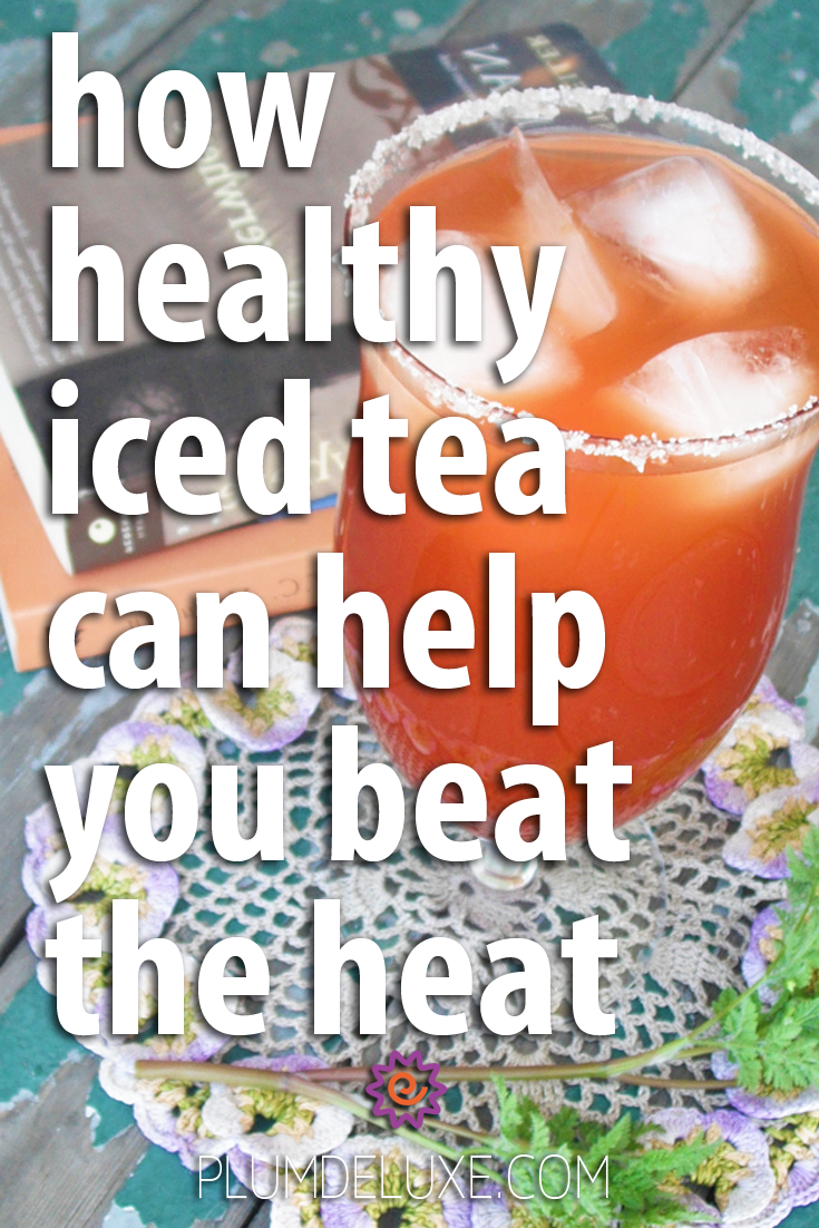 A glass of brightly colored iced tea sits on a crochet floral coaster next to a stack of books. The words read: how healthy iced tea can help you beat the heat.