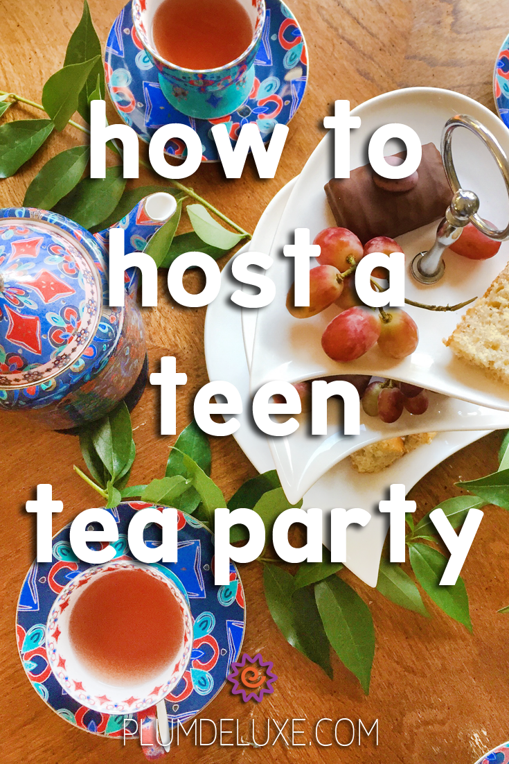 Overhead view of a tiered serving dish full of fruits and sweets, surrounded by a teapot and teacups in a blue and red geometric pattern. The words say: how to host a teen tea party.