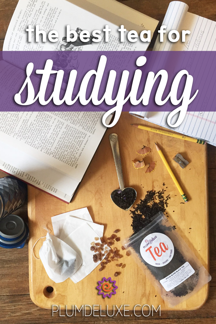 Overhead view of studying materials like books, note paper, and pencils along with a scoop of loose leaf tea, scattered on a wooden table. The words read: the best tea for studying.