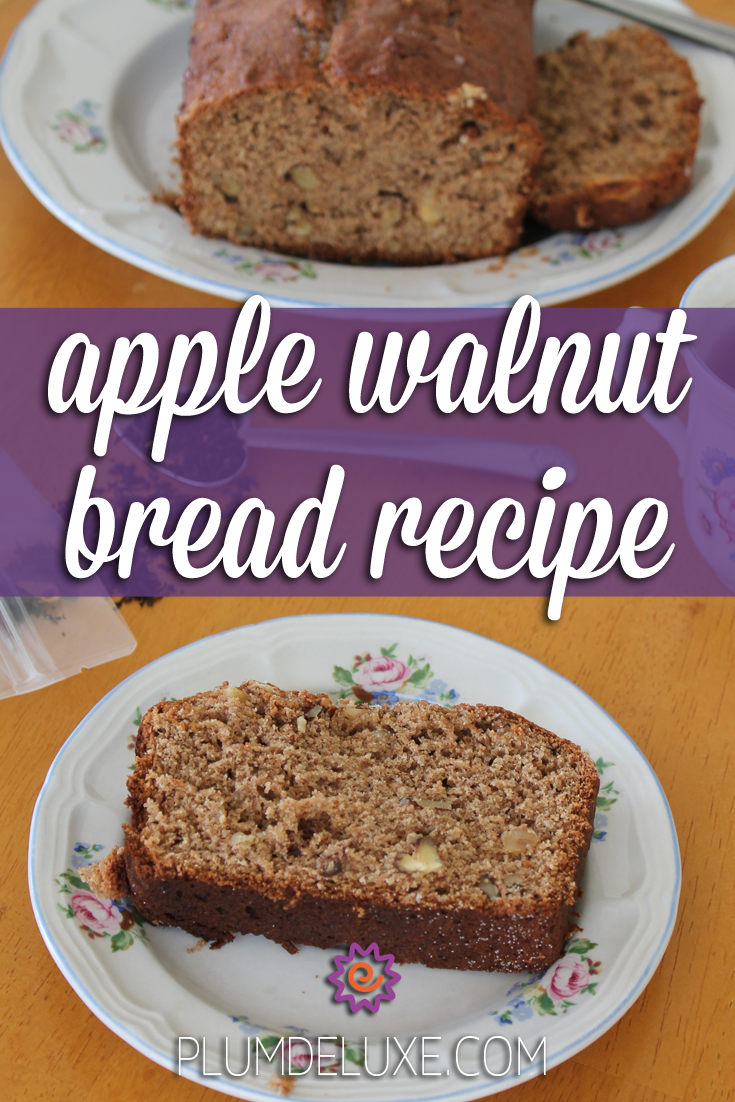 A slice of apple walnut bread sits on a white floral plate in front of the rest of the loaf on an orange table. The overlay words say: apple walnut bread recipe.