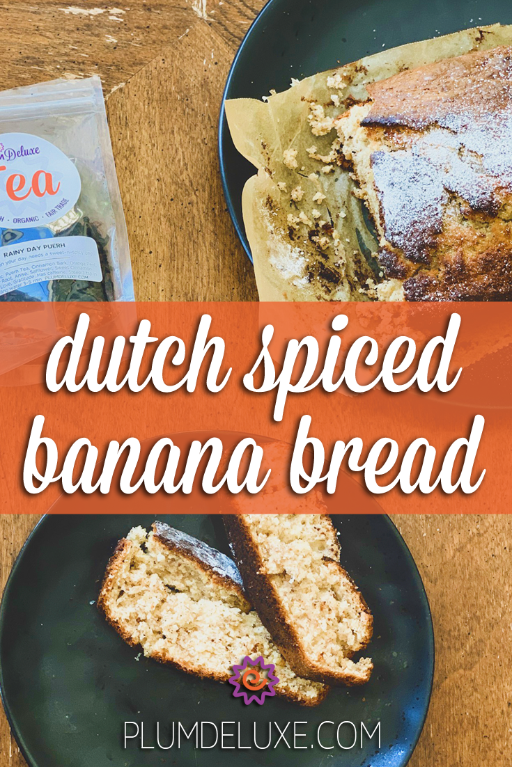 Overhead view of a loaf and two slices of banana bread along with a bag of plum deluxe loose leaf tea on a wooden table. The overlay text reads: dutch spiced banana bread recipe.