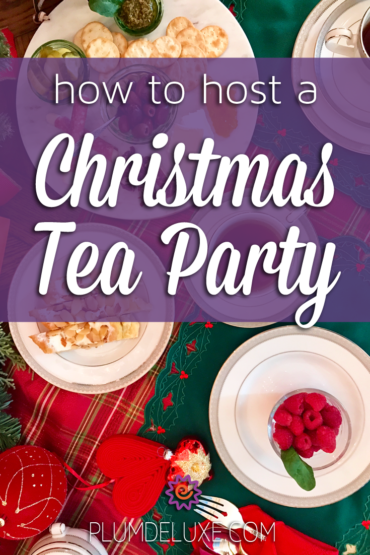 Overhead view of white dishes filled with raspberries, almond puff, and charcuterie and white teacups full of tea arranged on red and green linens. The overlay text reads: how to host a Christmas tea party.