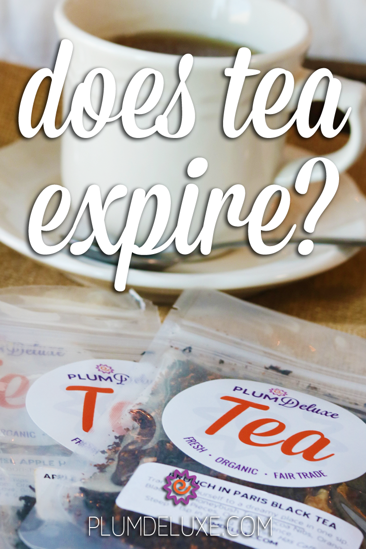 Packets of Plum Deluxe loose leaf tea are fanned out on front of a white teacup and saucer full of tea. The overlay text reads: does tea expire?