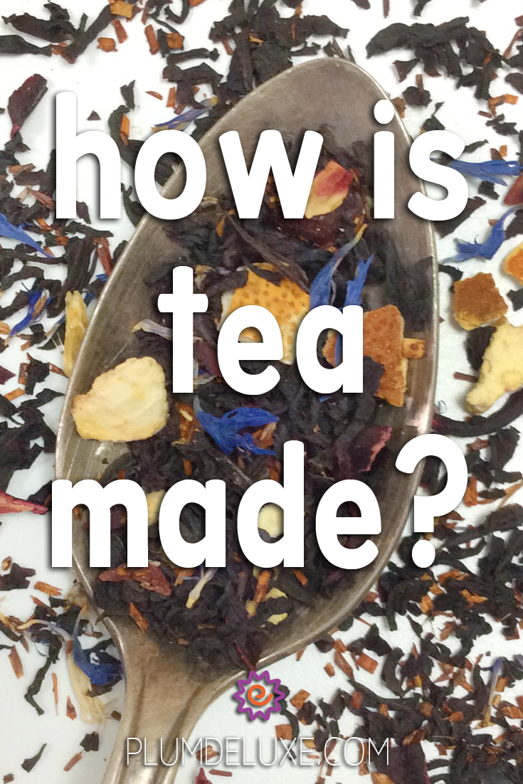 Overhead view of a spoon full of loose leaf black tea with orange peels and blue cornflowers on a white surface. The overlay text reads: how is tea made?