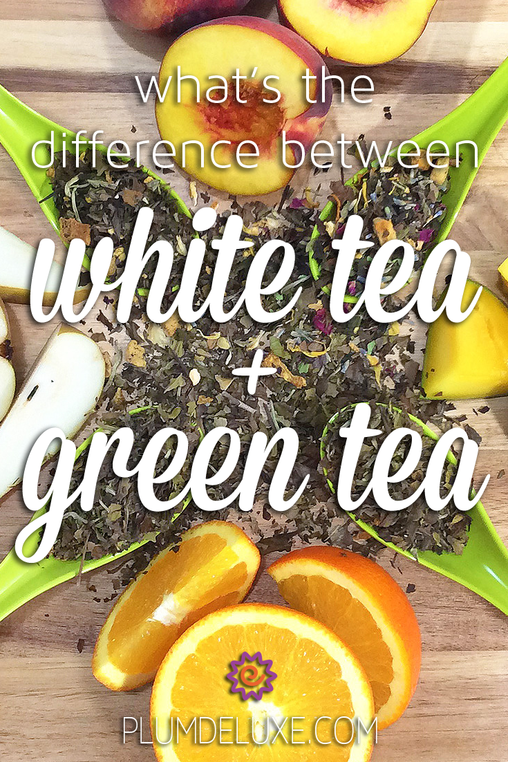Overhead view of four green spoons spilling over with loose leaf green and white tea. They are arranged on a wooden table and surrounded by oranges, mangoes, peaches, and pears. The overlay text reads: what's the difference between white tea and green tea.