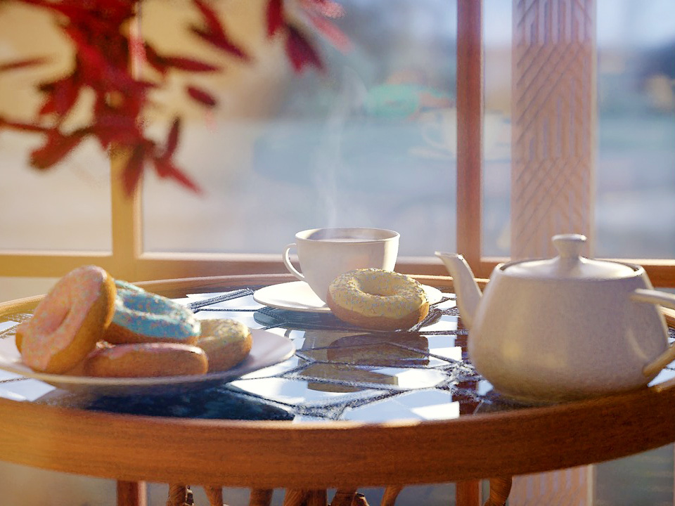A white teapot and matching teacup, as well as plates of donuts with colorful icing, are arranged on a table in front of a window.