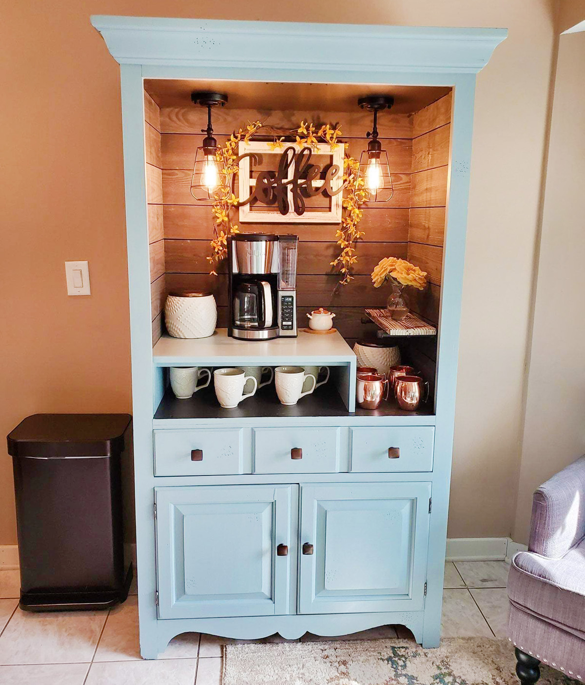 A blue hutch has been turned into a tea and coffee station.