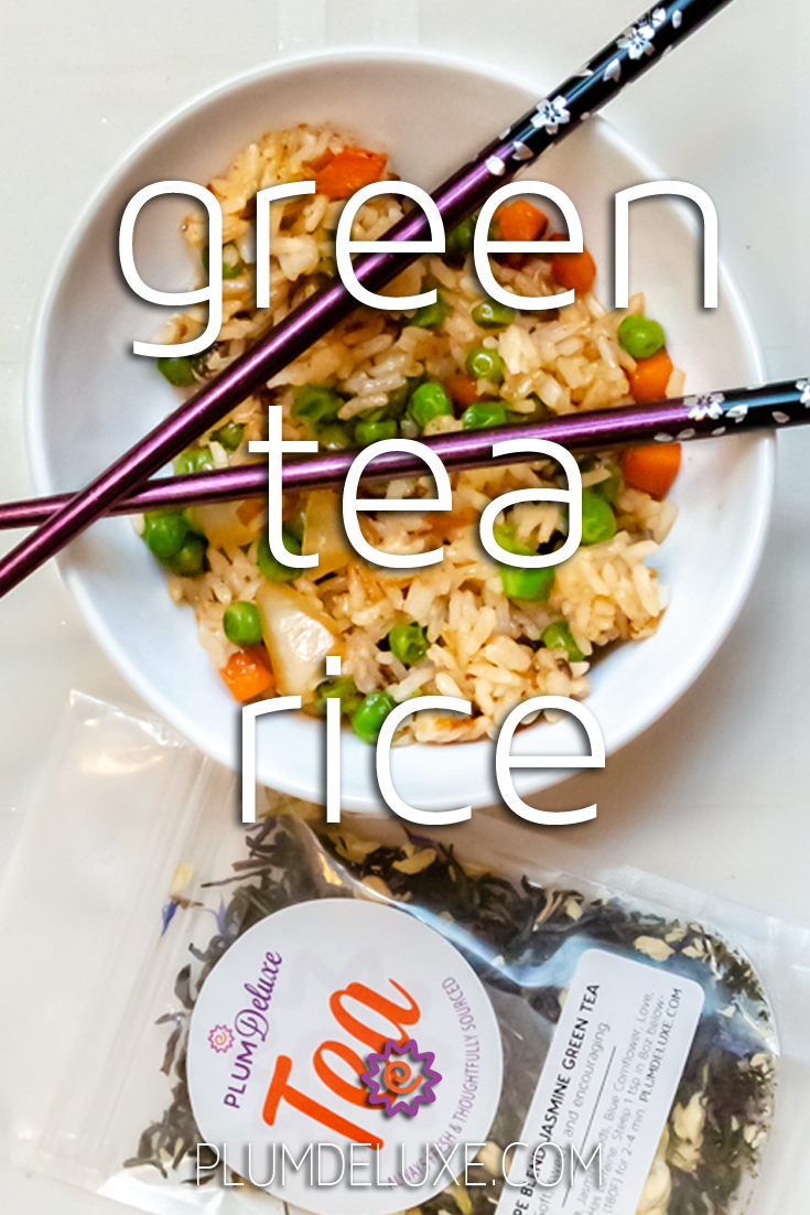 Overhead view of a white bowl full of fried green tea rice with a pair of purple chopsticks resting on top. Beside it is a bag of Plum Deluxe jasmine green tea. The overlay text reads: green tea rice.