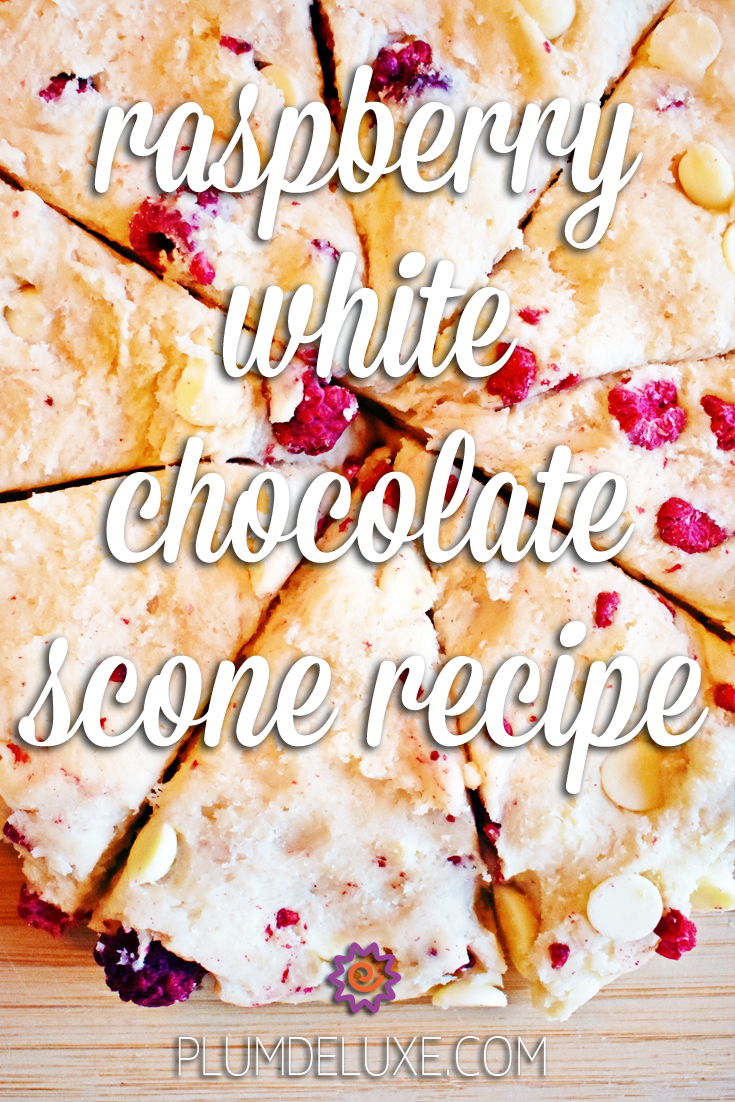 Overhead view of eight raspberry white chocolate scone wedges in a circle. The overlay text reads: raspberry white chocolate scone recipe.