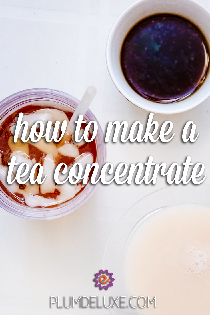Overhead view of a white ceramic cup full of tea concentrate, a jar of iced tea with ice cubes and a straw, and a glass of milk on a white surface. The overlay text reads: how to make a tea concentrate.