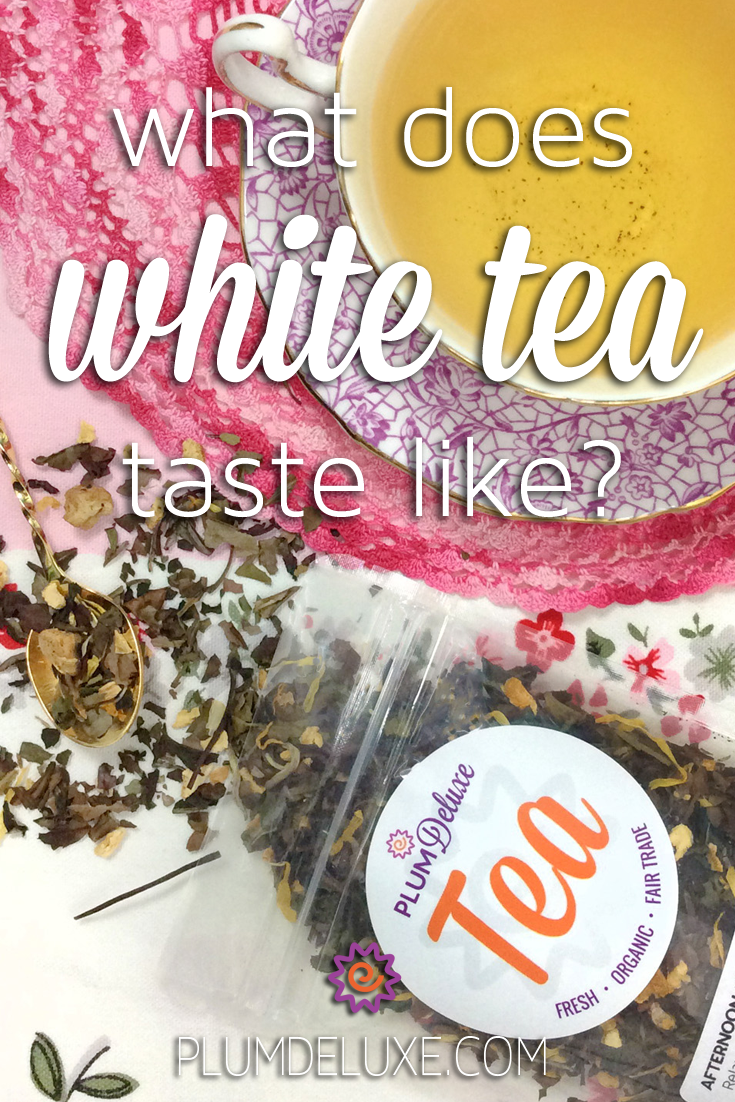 Overhead view of a package of Plum Deluxe loose leaf white tea laying open on a white cloth next to a purple and white teacup and saucer on a pink crochet doily. The overlay text reads: what does white tea taste like?