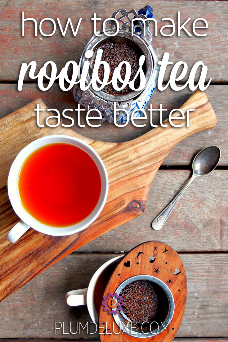 Overhead view of three cups of red rooibos tea on a wooden table. The overlay text reads: how to make rooibos tea taste better.