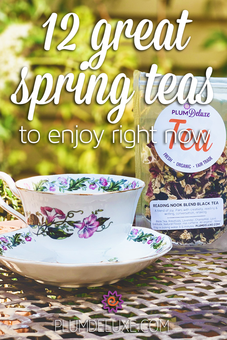 A white floral teacup and saucer and a packaged of Plum Deluxe loose leaf tea sit on an outdoor patio table in front of an elderberry flower bush. The overlay text reads: 12 great spring teas to enjoy right now.