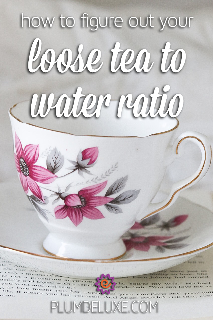 A white teacup with pink flowers sits on top of a book. The overlay text reads: how to figure out your loose tea to water ratio.